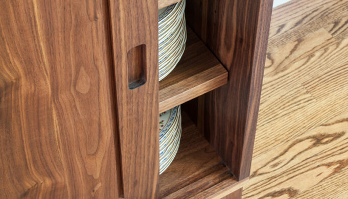 Shelving and sliding door detail Maria's Sideboard - walnut sideboard by Infusion Furniture - Milton MA