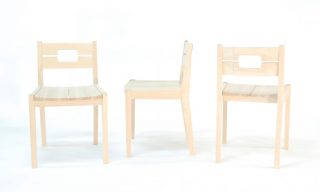 Custom dining chairs for Kit & Ace. Solid ash with contoured wooden seat.