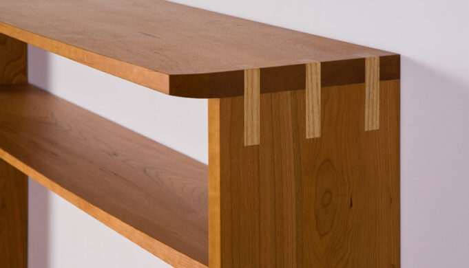Bowfront Console Table showing elegant contrasting joinery detail
