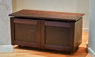 Rolling media cabinet of wenge wood and perforated aluminum panels