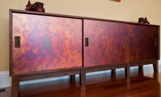 Customized sideboard with dramatic metallic texturing in a walnut case - Infusion Furniture