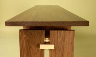End view of the floating top console table - Trilogy Table by Infusion Furniture