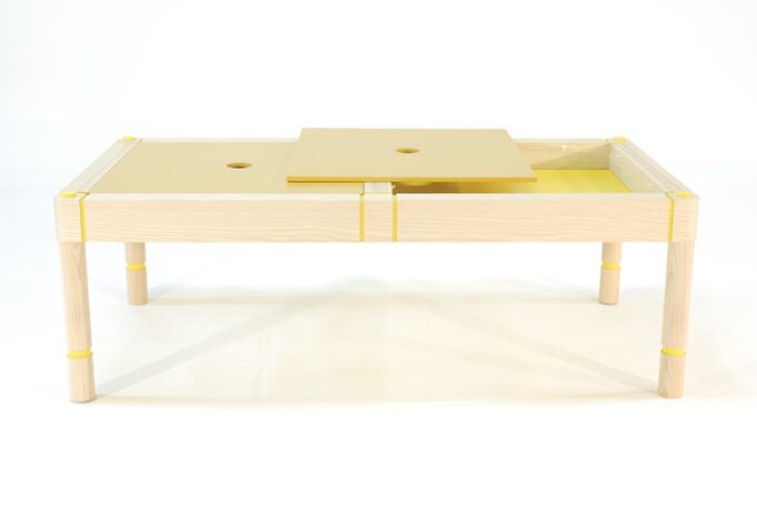 Side view of storage coffee table showing one top panel removed