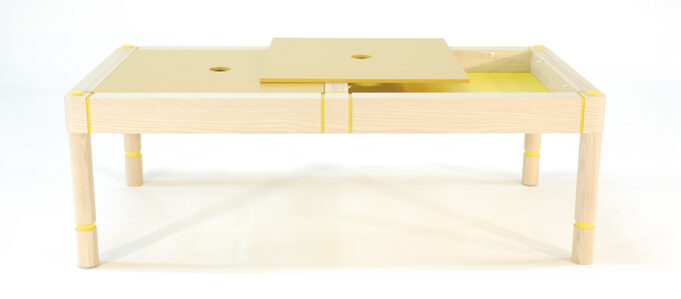 storage coffee table with yellow lacquered removable panels