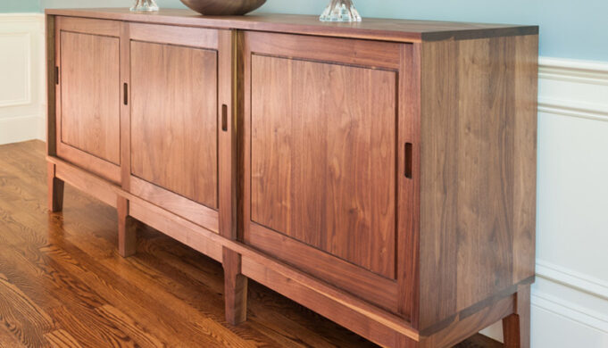 Frontal view of custom sideboard in walnut by Infusion Furniture