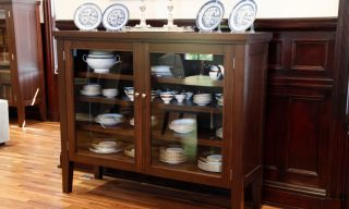Library cabinet in walnut by Infusion Furniture - shown being used as dinnerware display cabinet
