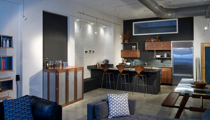 Loft kitchen showcasing custom kitchen cabinets