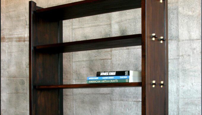 Pinned bookcase in walnut and ash by Infusion Furniture